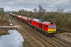 17th MaR 2018:  Accelerating away from Hawkeridge Junction is 60091 'Barry Needham' taking 6B33, the Murco empties, from Theale to Margam