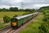 16th Jun 2018:  Introduced in 1957 the pioneer Clas 201  Hastings 'Thumper' unit 1001 hurries through Berkley Marsh near Frome on time as it works back to Hasting after a trip to Paignton.  It is a shame that only four of the original six car set were preserved so that two 'fat' coaches have to be used in the middle.