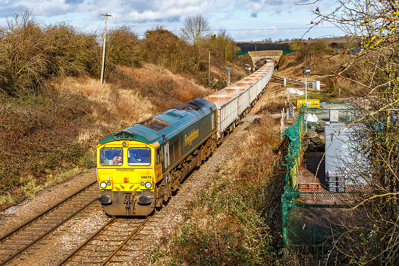 5th Feb 2021: Working a clean rake of empty boxes is 66619 'Derek W Johnson MBE' in a very wecome patch of sunshine.  6C68 is at Hawkeridge Junction with the 11.31 from Avonmouth to Whatley Quarry.  The July 1942 opened link to the Berks & Hants line goes off to the right.