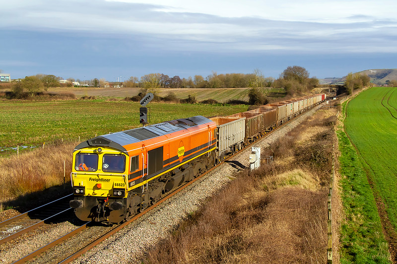 23rd Feb 2021:  Having reversed at Westbury 66623 that is working 6V17 to Whatley from Fareham is captured as it runs between =The station and Fairwood Junction..