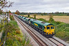 22nd Oct 2020:  Now fast becomming a regular runner is 6Z26.  This starts from Whatley Quarry at 10.23 and runs to Willeseden South Western Reversing Siding. Today in the hands of 66606 it is pictured passing through the site pof Edington & Bratton Station that closed in the early 1950s.  The old goods shed can be seen in the distance and the yard contains a number of small businesses.