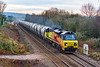 8th Dec 2010:  Powering down the grade away form Hawkeridge Junction  15.35 through Heywood is 70806 that is taking the empty PCAs back to the Aberthaw Cement Works from the Westbury storage facility..