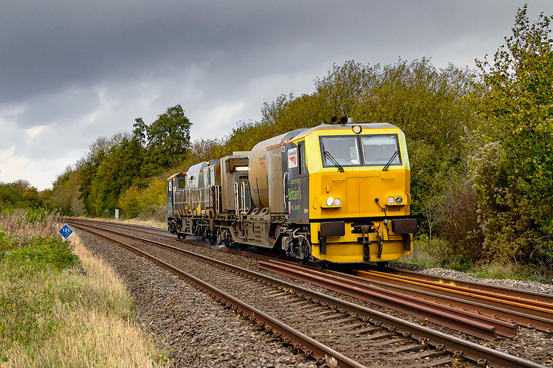 25th Oct 2020:  MPV DR98914/98964 is  pictured as it passes the foot crossing on Sherrington Lane in the Wylye Valley.  3S87 is a Sunday working form Totton  that covers the line from Fareham to Warminster via Eastleigh.  During the week the Wylye Valley line is covered by a service from Effingham Junction  The sun vanished about a minute before the train came into view but at least I did not get wet.