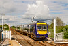 19th May 2021:  Crossing tha manually crontrolled level crossing at Hammerton is 170164 that is forming 1C20 the 09.29 from Leeds to York.  Thwe double track only goes back the  the previous station at Cattal.
