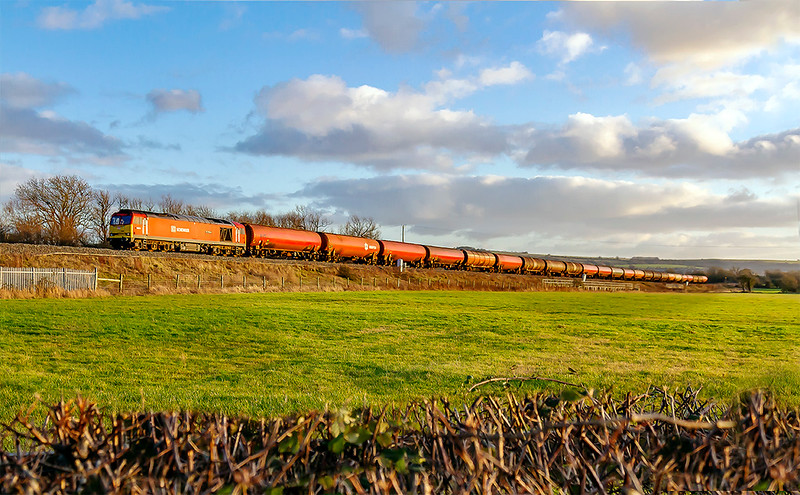 3rd Jan 2020:  Recent timetable changes have resulted in the Theale Robeston empty tanks being pathed via the Berks & Hants line.  6B33 powered by 60020 is pictured at Yarnbrook shortly after it had joined the Wilts Somerset and Doerset line at Hawkeridge Junction.. It will leave that line at Bradford Junction as it heads towards Bristol.