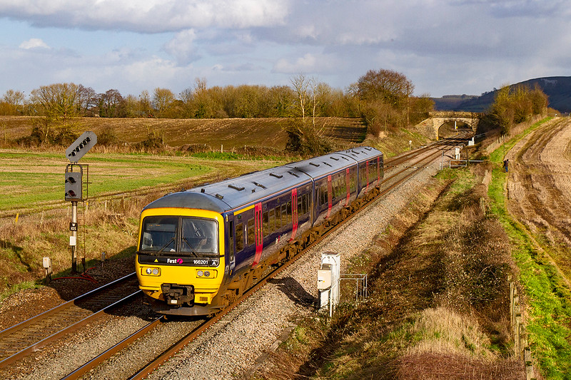 26th Feb 2020:  Still in the old FGW blue scheme 166201  is heading to Weynouth as it works 2Z78 the 12.42 from Great Malvern to Weymouth. through Fairwood