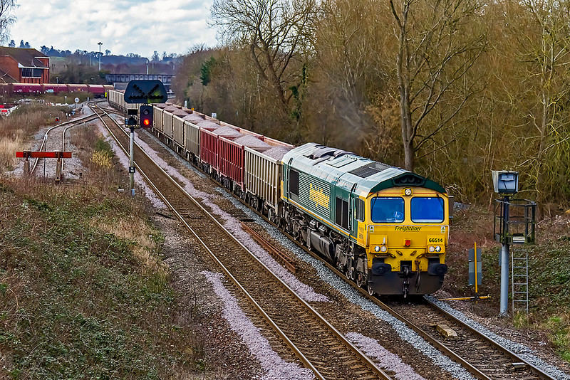 """5th Mar 2021: Yet another picture from the bridge at Hawkeridge """"Oh for the end of Lockdown !'.  This is the first time that I have ever pictured this service though. 66514 is working 6A60 to Oxford Banbury Road from Whatley Quarry"""
