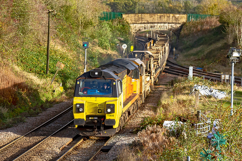 1st. Nov 2020:  The  07.00 LWR train from Swindon to Westbury  in the hands of   70806  was due to start. at 07.00 but actually left 80 minutes earley.  Due to over running works at Bradfrod Junction is was now 58 minutes late at this point.  Had it been on time  I would not have been out for the picture as it was very clooudy.