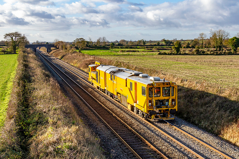 3rd Jan 2020:  NetworkRail.s Pandrol Jackson Stone Blower DR 80205 is pictured at Edington on the Berks & Hants line.  I do not know the know the working code but it started from Taunton and was going to Didcot Fuelling Point.