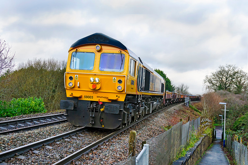 19th Dec 2019: Climbing steadily through the very recently  cleared Dilton Marsh is 59003 on the point of 6O41 from  Westbury to Eastleigh. The very long rake of mainly  OCAs  were all loaded with new bags of ballast.
