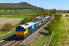 22nd Apr 2021:  This week the daily departmental between Westbury and Eastleigh has t5his week  been in the hands of 66734 but the word was the 66789 would be included on nthe day's retun leg. Picturd from Granada bridge on the Warmiinster Bye Pass the preferrd star was leading with 66719 & 66734 but no load.  Full sun so can't complain. too much.