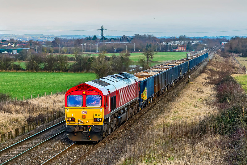 5th Jan 20211:  This is the first time that I have pictured 6M15 the 07.07 from Tytherington to Calvert.  Today it is headed by 66107 with the usual rake of larger blue JNAs and is captured  at Heywood as it slows for using the link to the Berks & Hants line at Hawkeridge Jinction.