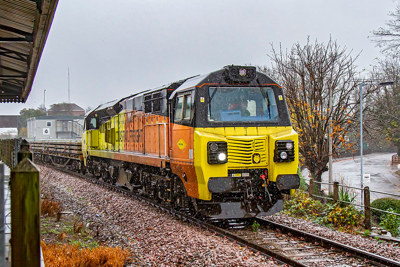 14th Nov 2020:  I got wet taking this one of  70802, with the numberless end leading, that is working 6C26 from Hinksey Sidings to Eastleigh.  It had started 108 minutes early at 8.02 but cut short it's lay over at Swindon so was 142 minutes early at this point where there was a crew change scheduled