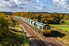 26th Oct 2020:    Running between Fairwood Junction and Westbury is 66606  hauling 6Z26 from Whatley Quarry to  Stoke Gifford.  This service can also run to Willesden South Western Reversing Siuding