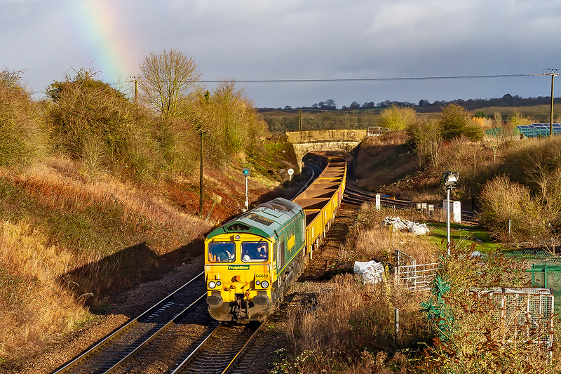 12th Jan 2020:  The rainbow shows that there was rain about but fortunately the sun and train came out at the same time at Hawkeridge Junction.   66610 is hauling 6Y16 from Southcote Junction to Westbury via Swuindon and Bath Spa where it had reversed. 66555 was on the other end