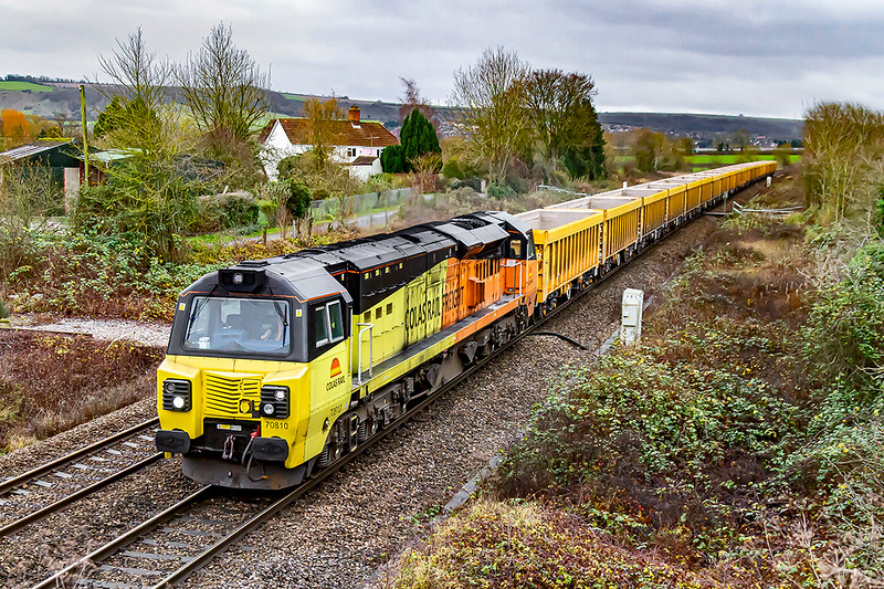 5th Dec 2019:  70810 is again tasked with heading 6M40 to Stud Farm in Liecestershire. with a rake of empty IOAs..  These wagons will return to Westbury after they have been filled with fresh track ballast.
