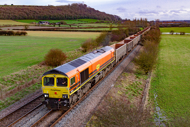 12th Feb 2020:  The Genesee & Wyoming liveried 66623 is rostered for 6V62 to Whatley from Southampton Up Yard.   Pictured as it runs between Warminster and Westbury from the bridge on the Warminster Bye Pass.