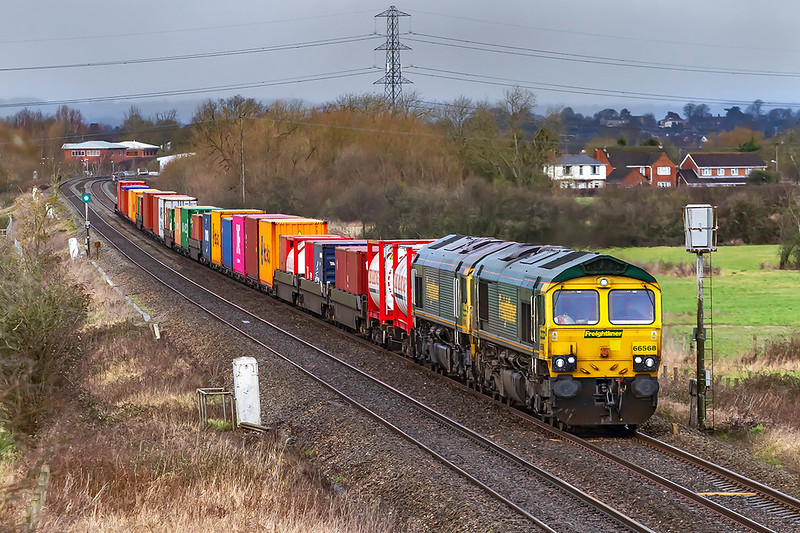 28th Jan 2020:  With 66568 providing the urge  and with 66548 tucked inside 4O57 is captured as they start the climb from Heywood into Westbury..  This service from Wentloog to Southampton Container Terminal is now a regular tunr through Westbury.  but the outward leg still goes via Swindon.