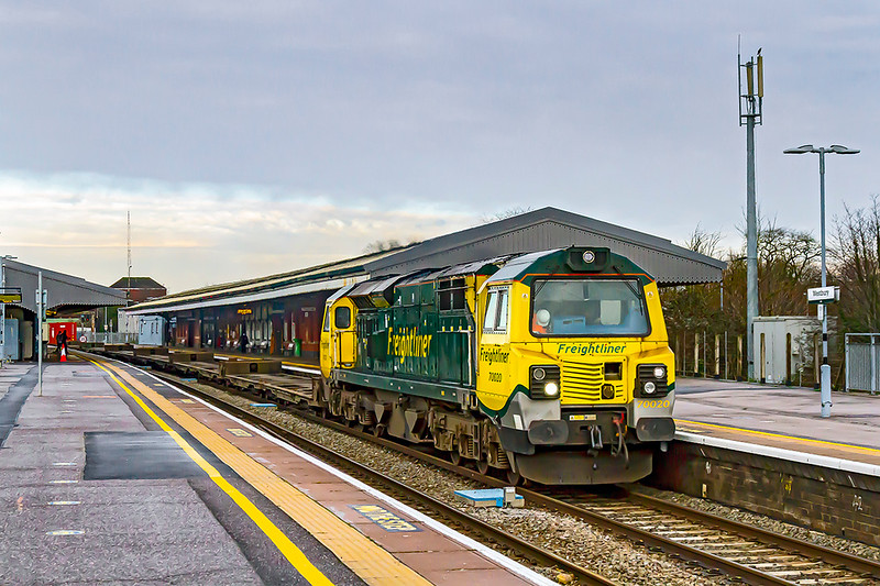 30th Dec 2020:   I only bothered to go out for 4O57 because it was a  class 70,  This service with 70020 at the helm running from Wentloog,near Cardiff, to Southampton Maritime Container Terminal is captured as it passes through Westbury's platform 1..  I wish that the ends of the canopies had not been painted that dark grey as the old pale cream colour would make the loco stand out much better.