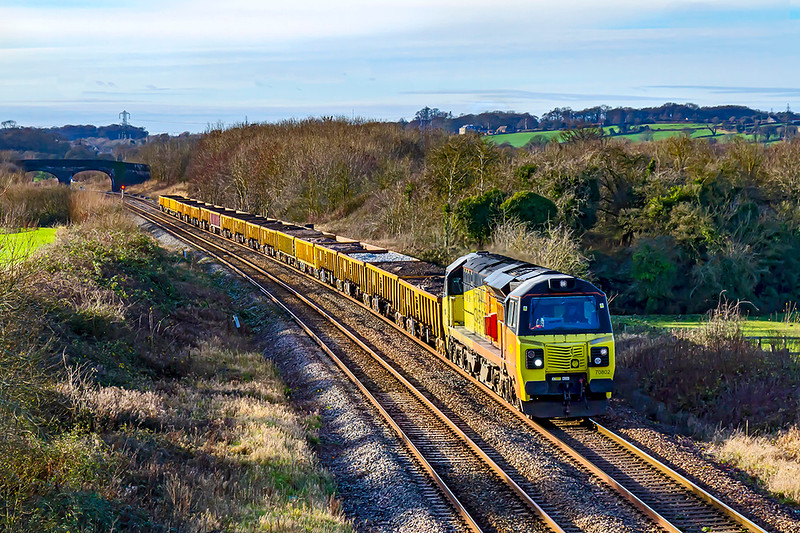 25th Dec 2020:  Had this run on time I would have been eating Christmas Pudding but fortunately it was 74 minutes early when it passed through Fairwood.   70802 is working 6C27 from Yatton to Westbury Down Yard.