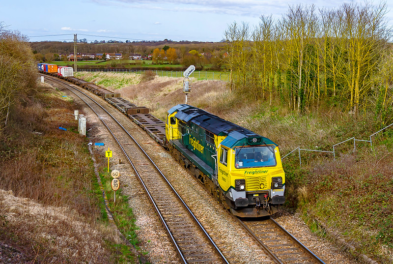 24th Mar 2021:  On the 11th Febraury 2011 I took my first pictire of a Class 70.  It was 70003 that was working the first ever duty of a 70 on 4O57 from Wentloog to Souhhampton.  I think that it might have been the first duty performed by a 70.  Today it is pictured at Shallow Waggon Lane near Hawkeridge Junction on  the same service..