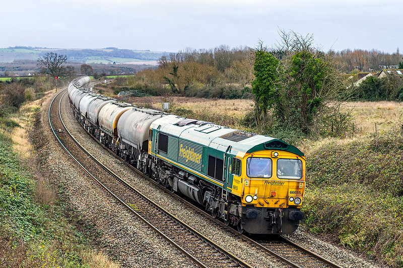 10th Dec. 2020:  Fortunately I had to be in the area near Mud Lane in Trowbridge so was able to capture 66615 as it works 6M36 the 12.17 from Westbury Lafarge to Tunsteead,.  The load is 24 empty JGAs and this service only runs occasionally so it was  worth a snap despite the crap weather.