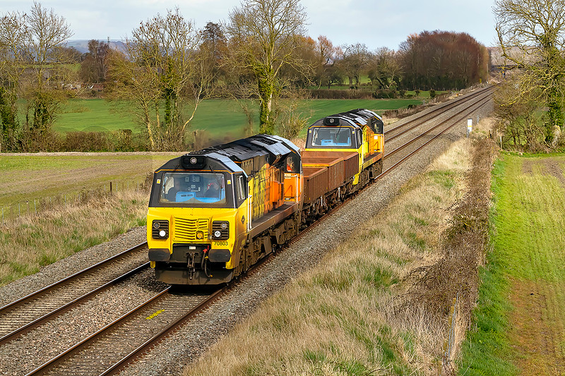 25th Mar 2021:   An unusual working is 6Z64 ithe 08.40 from Derby CS to Westbury via Oxford and Reading.. Knowing thatr it was powered by a pair od Colas 70s it eemed to be worth the effort to go to Edington for a picture.  70803 & 70808 Top n Tailing three empties is not quite what I had expected.