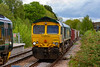 26th May 2021:  Passing trough Warminster Station is 66622 that is bringing 7V16 from Fareham to Whatley.  Sitting in the other platform is 158798 that is forming  1O98 the 10.41 from Great Malvern to Brighton.