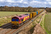 2nd Mar 2020:  6B03  is the Pong Liner from Northolt to Severnside Sita.  Today powered by 66207 it is slowing to go into the loop at Woodborough on the Berks  & Hants line. This action is to let 1C80 the 12.02 from Paddington to Penzance to over  take it.