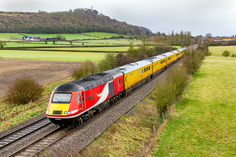 11th Mar 2021:  Fortunately the heavy rain had just stopped when 1Q23 the Network Rail tester  from Reading to Exeter and back nears Warminster on the leg to Westbury.  The only reason that iI bothered tp go was because Ex LNER 43299, now with Neywork Rail branding, was one of the locos.  The location with Arn Hill in the distanceis the bridge on the Warminster Bye Pass..