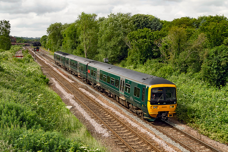 """23rd Jun 2021:  1F10 is the 08.25 from Portsmouth Harbour to Cardiff Central today in the handss of 166204..  A very ordinary working but the set is named. """"Norman Topsom MBE""""  who retired as station master at Twyford in November 2015 after 50 years of service.  I was very fortunate  to have talked to him on many occasions.  He was a lovely man. so worth gettong another picture."""