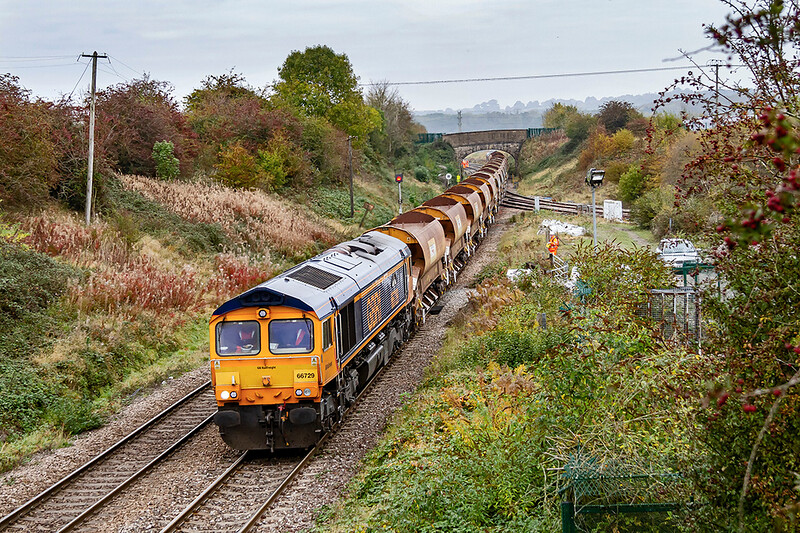 18th Oct 2020:  Almost 13 hours aftet it left Westbury 6G70  Top n Tailed by 66729 'Derby County' and 66754 'Northampton Saints' is almost home as it passes through Hawkeridge. The three sets of Auto Ballasters had ben emptied  tat Bridgend