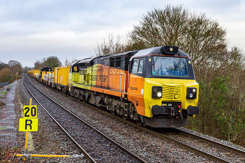 11th Jan 2020:  Although it started 90 minutes late from Hinksey Yard is  just 4 late as it climbs through Dilton Marsh as it works 6X26 to Eastleigh.  With X in the code I thought that it might be worth the effort to get a picture.  I had not expected to  see a new large NetworkRail 'Multi Tasker' crane, a good rake of loaded HOBC wagons and a string of JNAs.  Note also that the Colas 'Helmet' badges have been removed from the cabs !