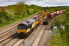 23rd May 2021:  6C30 is arriving at Westbury, in a surprising patch of sunlight, is 66848 top 'n tail with 66846 which are bringing a decent rake of JNAs from Henwick Junction in Worcester to the Down Yard..