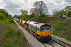 30th Apr 2021:   66753 'EMC Roberts Road' is bringing up the rear of 6G70 that is running from Westbury to Crediton with two sets of Autoballasters..  Pictured from the foot bridge over the `Frome Avoider that is at the end of Styles Avenue.