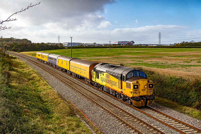 31st Oct 2020:    Colas 37099 'Merl Evans 1947-2015'' is now leading on 5Z02 as it returns to Bristol High Level Siding  after it's run to Weymouth earlier in the morning.  The early rain had stopped and the skys were clearing but unfortunately a cloud was just taking the edge off the light as the train came into view at Berkley near Frome.