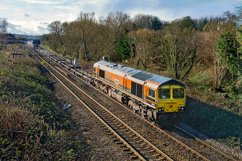 17th jan 2020:  Leaving Westbury as it works 4V54 from Southampton Maritime Container Terminal to Avonmouth West Wharf is 66415.  This loco has recently been rebranded into the new livery and has been named 'You Are Never Alone' . A pitty all the boxes are on the other end.