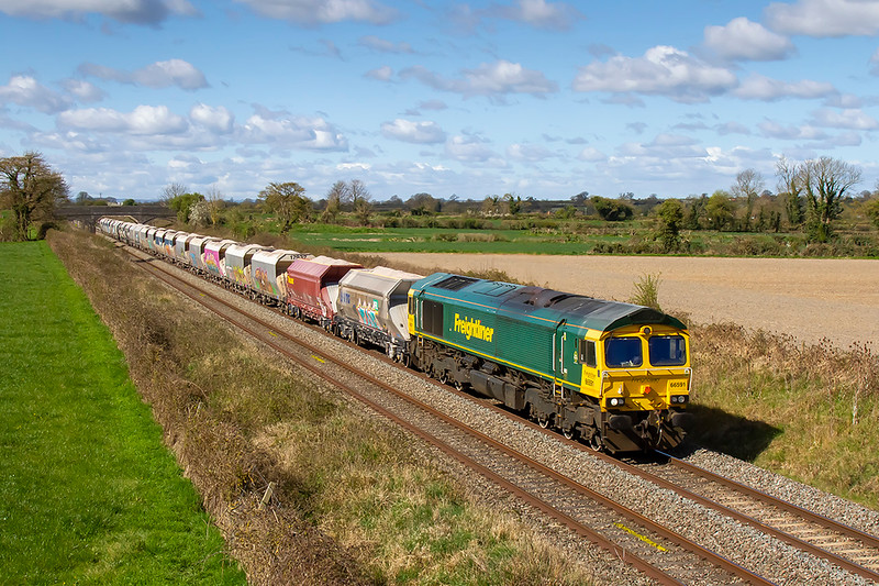 6th Apr 2021:  Doing the bussiness on 6M20 fron Whatley Quarry to St Pancreas is 66591.  In lovely lihght it is captured passing through Edington on the Berks & Hants line..