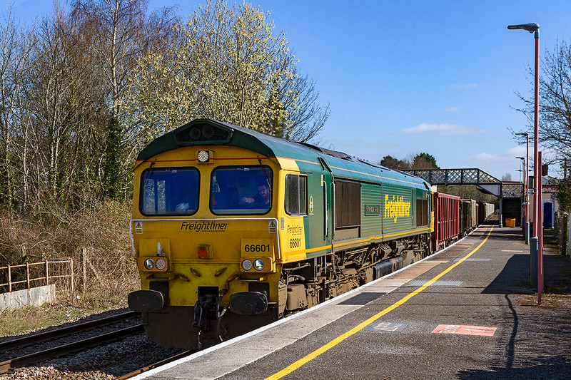 22nd Mar 2021;  Having left Fareham at 11.55 66601 'The Hope Valley'' is passing through Warminster with 7V16 to Whatley Quarry at  13.32,