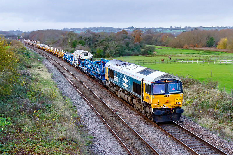 18th Nov 2020:  Just before it started to rain 66789 'British Rail' (it was originally 66250) is leading on 6G70 from St Budeaux Junction to Westbury at Fairwood.  It was supposed to have run yesterday evening but that was cancelled and re scheduled to start at 04.40 today.  The Balfour Beatty single line track relaying machine is at the front.  66790 is on the other end.