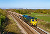 16th Apr 2016;  Running 20 minutes early through Fairwood is 66606 that is taking 6A60 from Whatley Quarry to Oxford banbury Roaod.  My intention was to picture this from the distant bridge at Fairwood Junction.  Unfortunatek=ly there were seven white NetworkRail vehicles parked by the junction that would have totally ruined the shot.  So this was my only option.