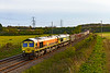 7th May 2021:   66623 & 66516 are running 15 minutes early as they power away from Clink Road Junction with 7C59 from Whatley to Westbury Tarmac sidings.  With it's engine running 66616 is on the other end.   The old cement works sidings are now used by Freightliner eo store  trains over night and to reverse them when going to  use the line through Salisbury.