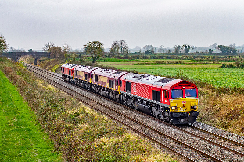 28th Nov 2020:  With the line between Warminster and Salisbury closed for engineering works 0O12 from Margam to Eastleigh was forced to use the Berks & Hants line.  Starting with six locos  two (66107 & 66160) were dropped off at Westbury.  The remaining four 66192, 66096, 66084 & 66044 are pictured from the bridge on Cowleaze Lane in Edington.