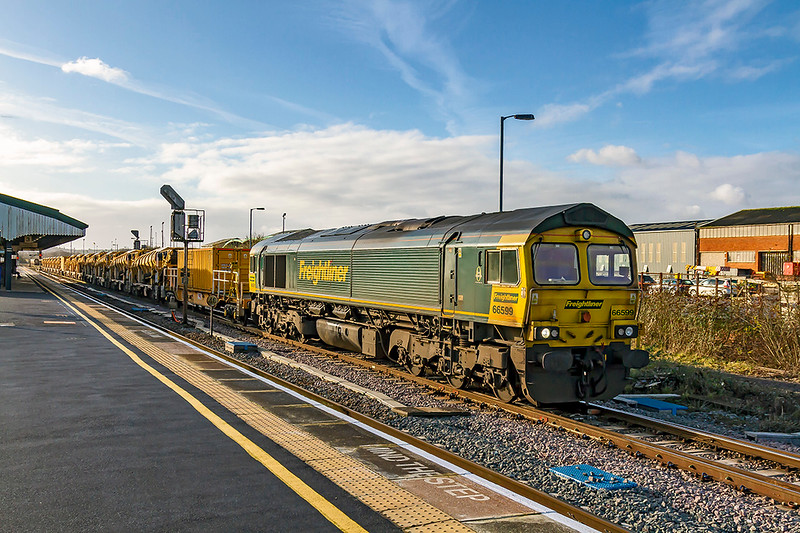 3rd Jan 2020:  66599 is leaving Westbury as it works 6C73 back to Fairwater via Bristol.  It is routed this way to that the loaded HOBC wagons are on the other end of the unit when it is rasembled at Fairwater Yard
