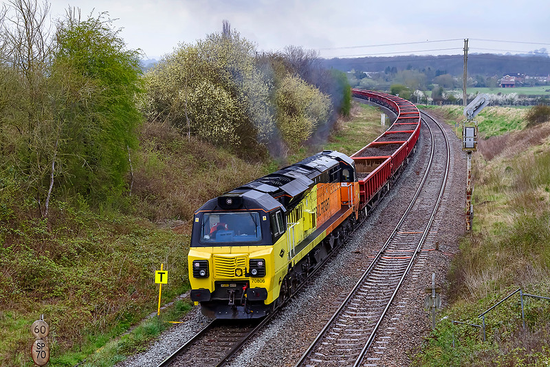 10th Apr 2021:  Having been halted while the other train  was pushed back out of the way 70806 is struggling to get a very long rake of loaded MXAs (Lobsters) up the hill through Hawkeridge Junction.  With 70803 out of sight 6C22 is working from Bradford Junction to Westbury.