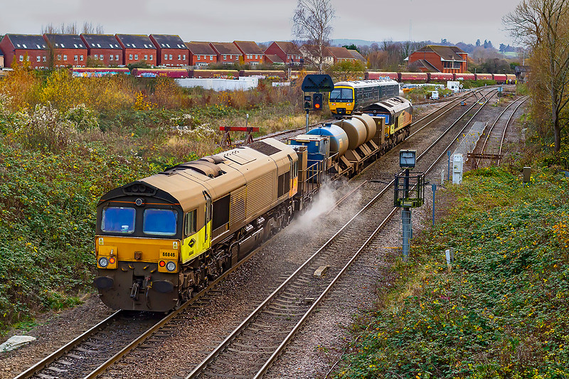 22nd Nov 2020:  At half past three climbing the last few  yards to Westbury Station is 3S57 the  Bristol Kingsland Road RHTT set that is in the hands of Colas pair  66846 and 66850..  Starting the working at 14.40 it should arrive back at base at 11.07 in the morning having travelled of most of the lines in South .It is good to see the the cab sides have been cleaned.` 165137 is resting in the siding, It returned to the station after the RHTT had passed.