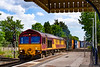 14th Jun 2021:  66013 is running through St Denys station as it works 4E68  from Southampton Eastern Docks Berth 109 to Wakefield Europort.. On a very hot day it was nice to sit in the shade and just stand up when a train comes.