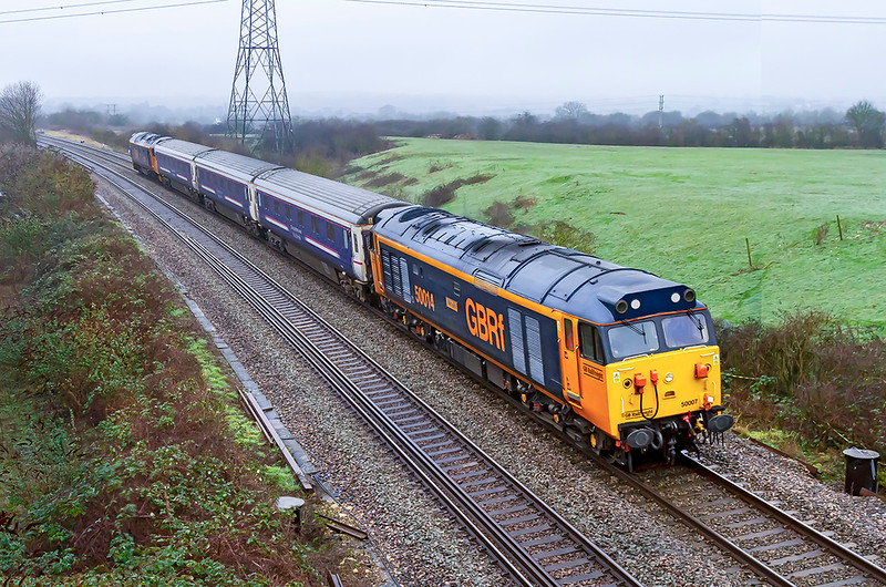 22nd Jan 2020:  Pictured on a crap dull, damp and misty day at Thingley Junction are 50014 'Warspite' Top n Tail with 50007 'Hercules' as they work 5Z50 from Wembley Inter City. Dpot to Laira with three  Ex Caledonian Sleepers..  In the right hand corner is the base for the 'future !!' electrification of the line  to Bristol via Bath Spa.