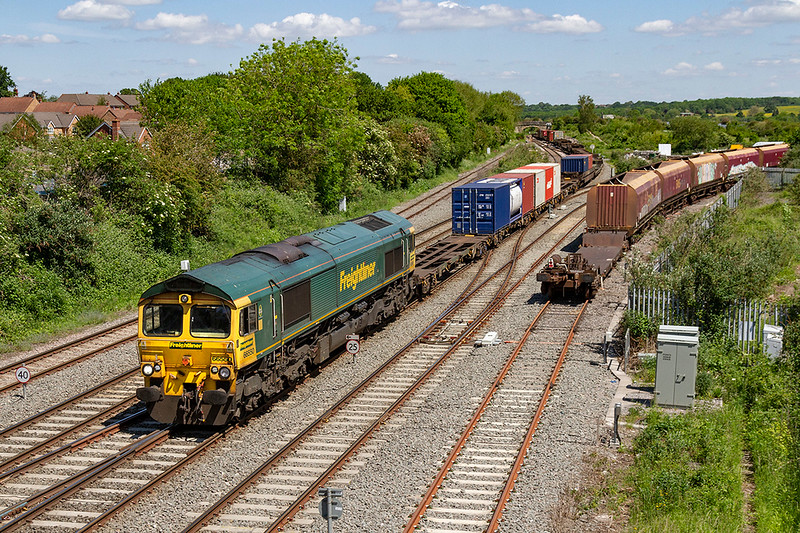 5th Jun 2021:  Running with the same motive power as yesterday 4O57 from Wentloog to Southampton Maritime behind  66550 is about to run through Westbury Station.