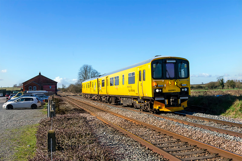 26th Feb 2026:  Network Rail  Tester 950001  is working as 2Z08 from Wesbury to Reading Triangle Sidings and is passing the old Goods shed on the site of Edington & Bratton station.